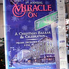Miracle On 7th Street: Detail of sign in window of downtown business.