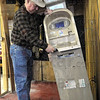 Tilt: Boot City businessman Rod O'Kelley checks the remains of his ATM after it was the target of theives.