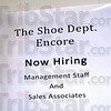 Now hiring: A Sign posted on a wall calls for applications for The Shoe Dept.