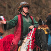 Tribune-Star/Joseph C. Garza<br /> Horses and choruses: St. Mary-of-the-Woods equine studies chair Chris Marks leads a Christmas carol during the seniors' ride through campus Tuesday.