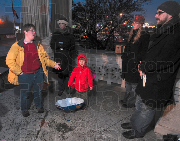 Tribune-Star/Joseph C. Garza<br /> Her take on health care reform: Ruth Fairbanks, left, shares her opinion about a public option Tuesday during a vigil under one of the awnings on the Vigo County Courthouse. Listening to Fairbanks are Margaret Hurdlik, Rebecca Hughes and MoveOn.org organizer Michael Myers.
