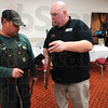 Tribune-Star/Joseph C. Garza<br /> An honest appraisal: Treasure Hunters Road Show's Jeff Ford, right, gives Montezuma resident Marc Dooley his honest opinion on a sword Tuesday at the Best Western.