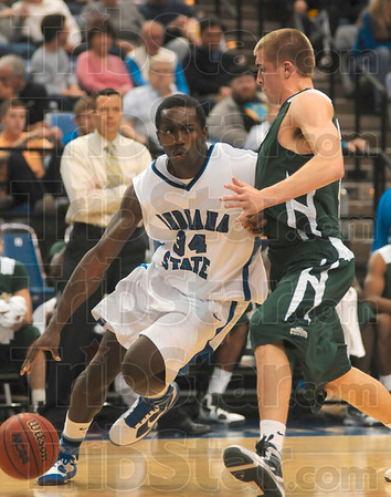 Tribune-Star/Joseph C. Garza<br /> Indiana State's Carl Richard drives to the hoop against a Colorado State defender Nov. 20 at Hulman Center.