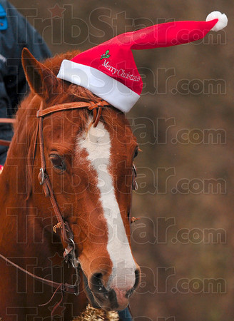 Tribune-Star/Joseph C. Garza<br /> In the holiday spirit: St. Mary-of-the-Woods equine studies senior Lauren Eggleston rides her horse, Milford, with a Santa hat, Tuesday on the school's campus.