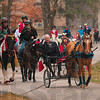 Tribune-Star/Joseph C. Garza<br /> A-neigh-zing grace: Members of the St. Mary-of-the-Woods College Equine Studies program, along with college president, Dr. David Behrs, in carriage with senior Tiffany Winhold of Pleasant Plains, Ill., fill the air with Christmas carols Tuesday on the school's campus. Every year the seniors in the program usually ride through the campus late at night in the spring but this year the seniors decided to ride Tuesday during the day and sing Christmas carols.