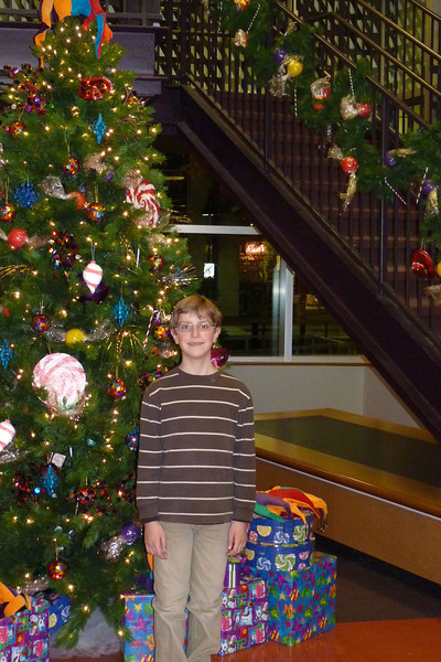 Anthony in front of the Christmas Tree at Imaginon