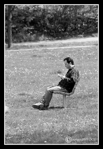 Man reading book at Henery Law Park