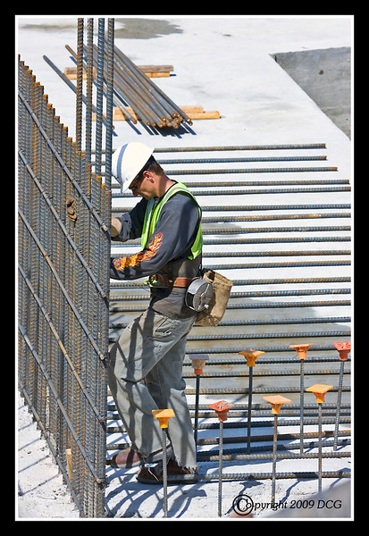 Construction Worker building forms for new bridge