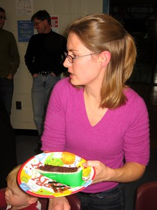 Eli's mom, Alex, serves slices of cake
