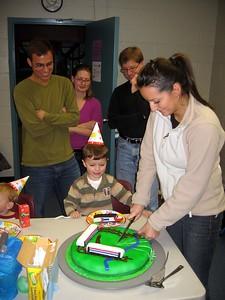 Olivia cuts the cake