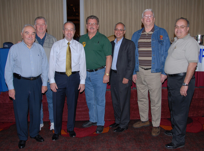 From the left, Marvin Anderman (Esq.), Marty Shannon (B.A.), Andre Finkelstein (Esq)., Joe Manley (V.P.), Vincent J. Rossillo (Esq.), Terry Daly (Treasurer), Angel Feliciano (Exec. V. P.)