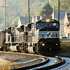 A pair of NS SD80MACs lead a eastbound loaded coal train through East Deer on the Conemaugh Line. October 19, 2009