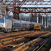 Amtrak Washington bound train 161 passes a Metro North Hyrail Truck on Saga Bridge in Westport, CT, November 22, 2009.