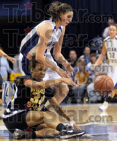 Scramble: Indiana State's #5, Shannon Thomas knocks the ball away from Wichita State's #34, Daria Frazier during game action at Hulman Center Thursday night.