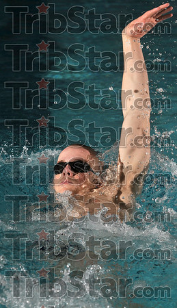 Tribune-Star/Joseph C. Garza<br /> Ready for Indy: Terre Haute North's John Craig Huster practices his backstroke form during team practice Thursday in the North pool.