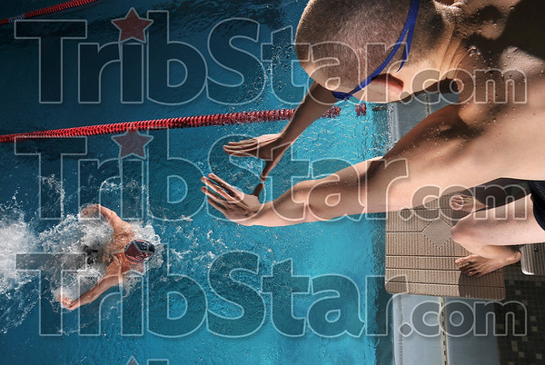 Tribune-Star/Joseph C. Garza<br /> Synced: Terre Haute North medley relay team members Paul Morris and Chris Huster practice in the school's pool Thursday at North.
