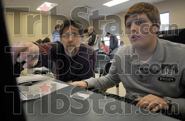 Application: Clinton resident Brian Nickels (L) and his son Caleb work in a computer lab Sunday afternoon at Ivy Tech  as they prepare a FAFSA application.