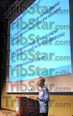 Welcome: Jan Benton of Ivy Tech greets a large gathering of parents and students Sunday afternoon in the auditorium on campus. The parents  with be filing FAFSA papers for college-bound students.