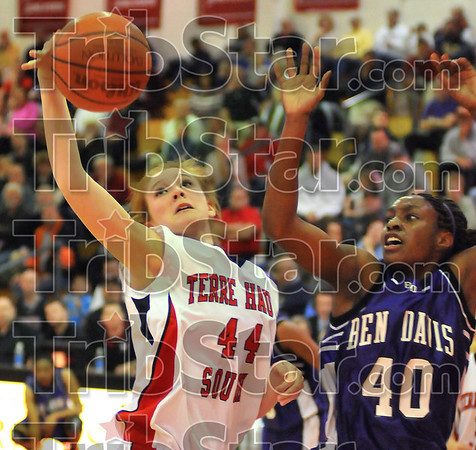 Relief work: Terre Haute South sub Hannah Lee grabs a rebound from Lady Giant DeAirra Goss.