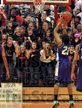 Crowd involvement: The X-factor, Terre HAute South Vigo High School's student cheering section, tries to distract Ben Davis' Alexandria Bentley while she shoots a free throw.