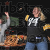 Second quarter excitement: Pittsburgh fans Kristin Cooper, right, and her son, Kade Cooper, 12, celebrate as they watch on a big screen television Steeler James Harrison run an interception back for a touchdown Sunday at Buffalo Wild Wings. The Coopers are from Pennsylvania and recently moved to Terre Haute.