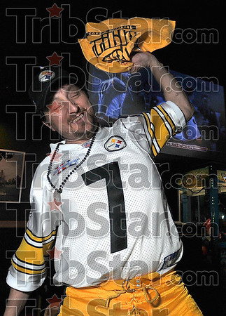 Terrible Towel Time: Pittsburgh fan Rob Hendricks, 39, waves his Terrible Towel at Buffalo Wild Wings as he watches the Steelers score their first touchdown Sunday.