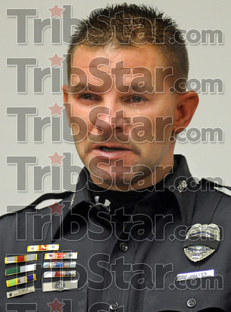 Partner: Terre Haute police K-9 officer Todd Haller tears-up during a ceremony honoring his deceased K-9 partner Friday afternoon at the police headquarters. His dog was one of two police dogs that recently died. The other was the partner of officer Brian Worley.