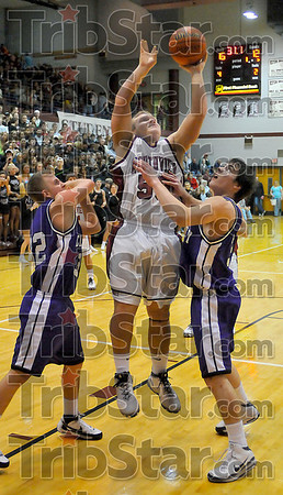 Muscle in: Northview's Jordan Keller muscles his way up for a shot against Eel defenders Kyler Rhodes and Orry Heffner.