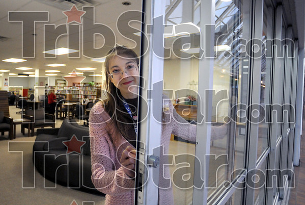 Sweet sorrow: Branch Librarian Jeanette Bouchie pulls the door closed for the last time Frida night as branch closes.