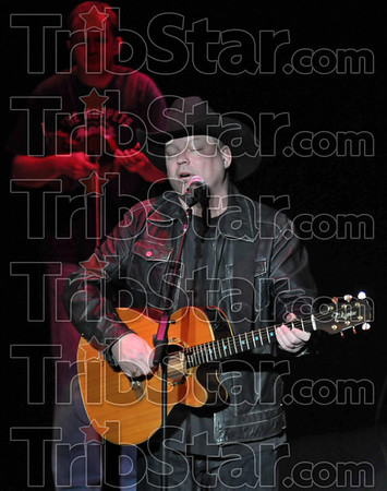Number one: John Michael Montgomery sings one of his 17 #l country songs during his concert at a sold-out Indiana Theater in Terre Haute Saturday night.