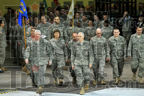 Back home again in Indiana: Col. Jeffrey Hauser and Col. John McGriff lead members of the 181st Intelligence Wing who have returned from deployment around the field at Lucas Oil Stadium Saturday during the Indiana National Guard Welcome Home Celebration in Indianapolis.