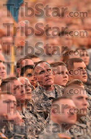 Scenes from Iraq: Soldiers with the Indiana Army National Guard watch large video screens as a video is played which features photos of themselves in Iraq during the Indiana National Guard Welcome Home Ceremony Saturday in Indianapolis.