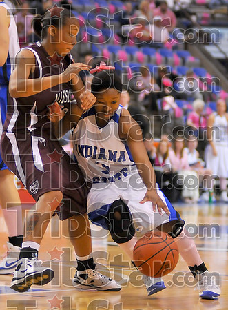 No where to go: Bianca Jarrett runs into Lady Bear defenderJaleshia Roberson as she attempts a move to the hoop.