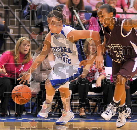 Moving in: Kara Schilli dribbles past Misouri State  defender Jaleshia Roberson.
