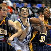 Squeeze play: Jay Tunnell works against Toledo players Ian Salter and Tyrone Kent, looking for a rebound.