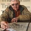 Planner: Sullivan Conty Airport board memeber Bob McCammon looks over the group's five year plan.