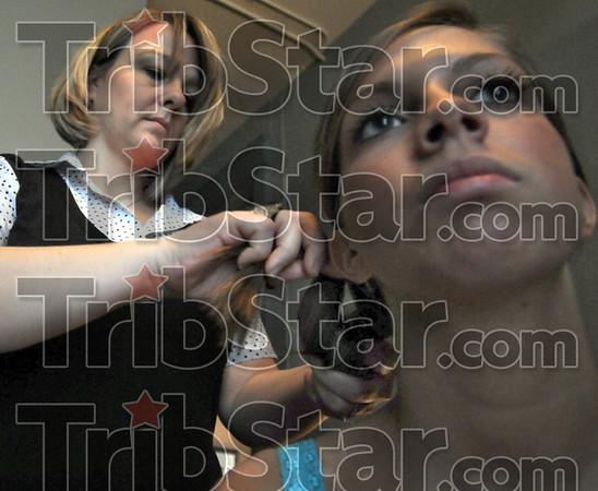 Prep: Hairstylist Stephanie Egan prepares model Sarah Helman for an advertising photo shoot Saturday morning.