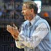 Approval: ISU head basketball coach Kevin McKenna encourages his team.