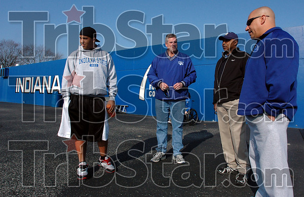 Campus visit: Marcus Lewis, left watches  the ISU football team warmup prior to scrimmage Saturday morning. He was visiting campus with his father Marvin, second from right, the head coach of the NFLs Cleveland Browns. Marcus Lewis has committed to come to Indiana State this Fall to play football for Trent Miles, right. With them is ISU Athletic Director Ron Prettyman.