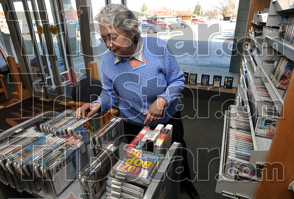 Tribune-Star/Joseph C. Garza<br /> Popular items at the Southland branch: Clerk Nancy Malloy prepares to place videos back on the shelf at the Southland Plaza branch of the Vigo County Public Library Wednesday, Jan. 21.