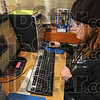 Tribune-Star/Joseph C. Garza<br /> Learning resources at the library: 13-year-old Tessa Clifton uses one of the computers at the West Terre Haute branch of the Vigo County Library to complete at geology report Thursday.