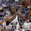 Got it: Indiana State's #23, Harry Marshall gets to a loose ball during game action at Hulman Center Wednesday night.