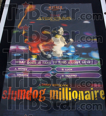 "Now playing: The playbill for Oscar nominated movie ""Slumdog Millionaire"", now playing at Honey Creek West."