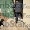 """Tribune-Star/Joseph C. Garza<br /> Don't wanna go: Terre Haute Animal Control Officer Jerry Arney tries to lead """"Blackie"""" into the Terre Haute Humane Society Wednesday after Arney picked up the dog wandering a neighborhood."""