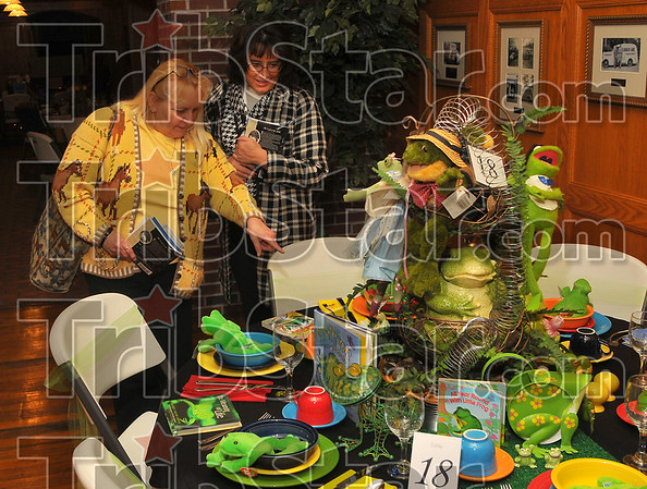 Goodhearted: Edie Wittenmyer and Judy Wells looks over the Altrusa entry in Tablescapes Wednesday evening at Clabber Girl.