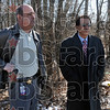 Precautions: Sgt. Frank Shahadey and Vigo Co. school superintendent Danny Tanoos watch the wooded area around Meadows Elementary school Monday afternoon as parents arrive to pick up their children in the wake of a cougar sighting in the area.