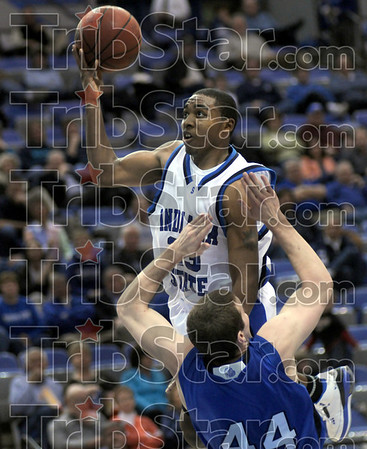 What?: Indiana State's #23, Harry Marshall is called for an offensive foul as he drives the ball to the hoop during first half action against Drake. Marshall also received a technical foul on the play when he remarked to the official.