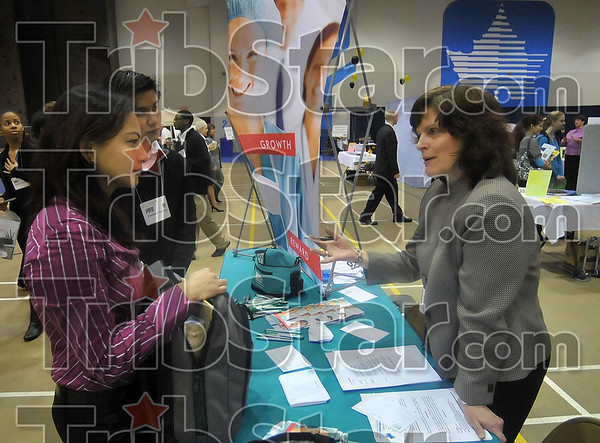Tribune-Star/Joseph C. Garza<br /> Career talk: Union Hospital campus recruiter Laurice Newlin, right, talks with students about careers in the field of hospital administration Wednesday during the Indiana State University Career Fair on the Indiana State campus.