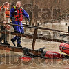 Tribune-Star/Joseph C. Garza<br /> Helping hand: Annetta Lindsay is led to a boat by Sugar Creek Fire Department Capt. Matt Pape as flood waters make it impossible for her to walk out of her home Wednesday on Old Paris Road.
