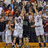 Crowd pleaser: Patriot Thomas Anderson blocks a shot in from of teh Terre haute North student section while his teammates Justin Gant(50) and Ross Sponsler(34) watch. Viking Joel Modesitt watches also.
